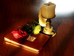 Book-rose-and-candle-on-teak