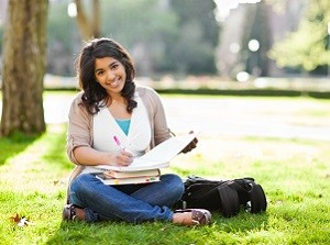 Distance Learning student, studying in a park