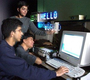 A group of distance learning students looking at a computer screen