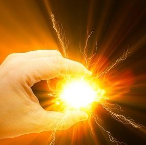 Hand holding an energy light