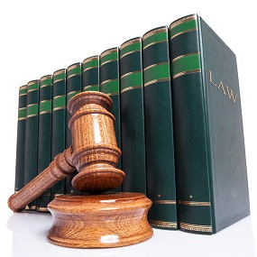 Law books with a gavel and sounding block