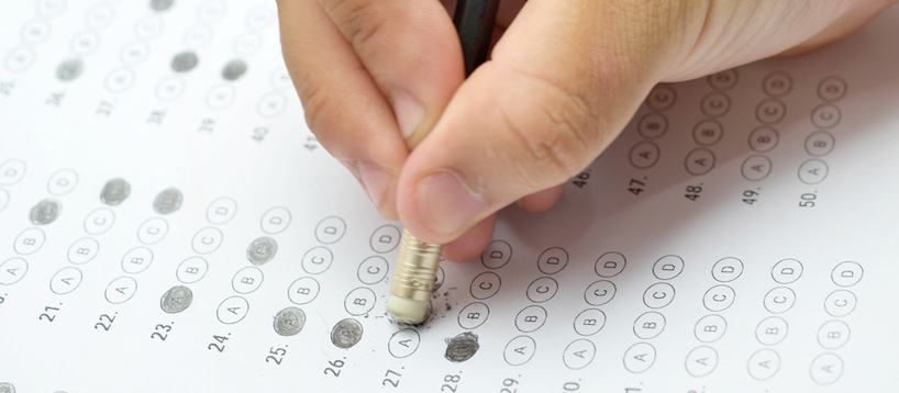 Student sitting a test with multiple choice questions