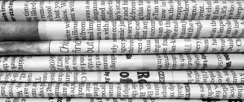English Language newspapers in a pile