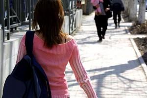 Student walking along pavement