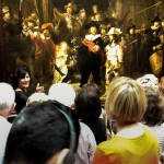 People looking at the painting `The Night Watch'