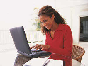 Mature distance learning student studying from laptop