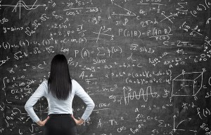 Mathematician in front of blackboard